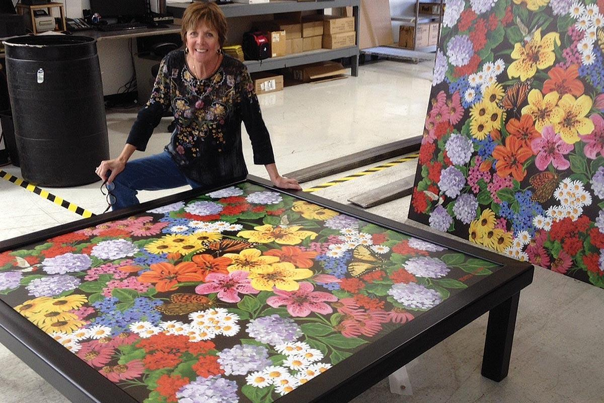 beth zink commissioned art table with painted flowers