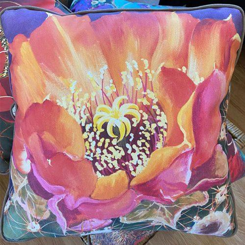 accent pillow with orange and pink flower