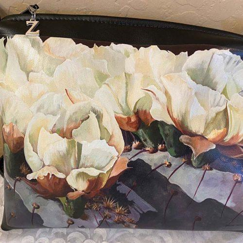 painted purse with cactus and white flowers