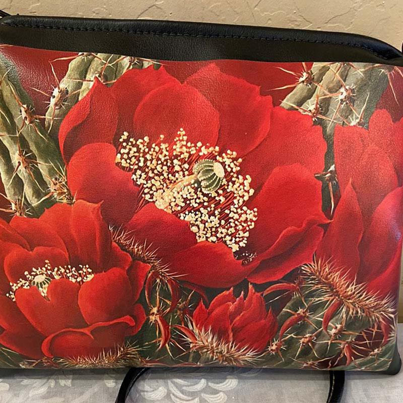 painted purse with bright red flowers