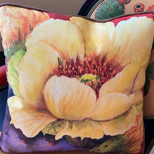 accent pillow with pastel yellow flower