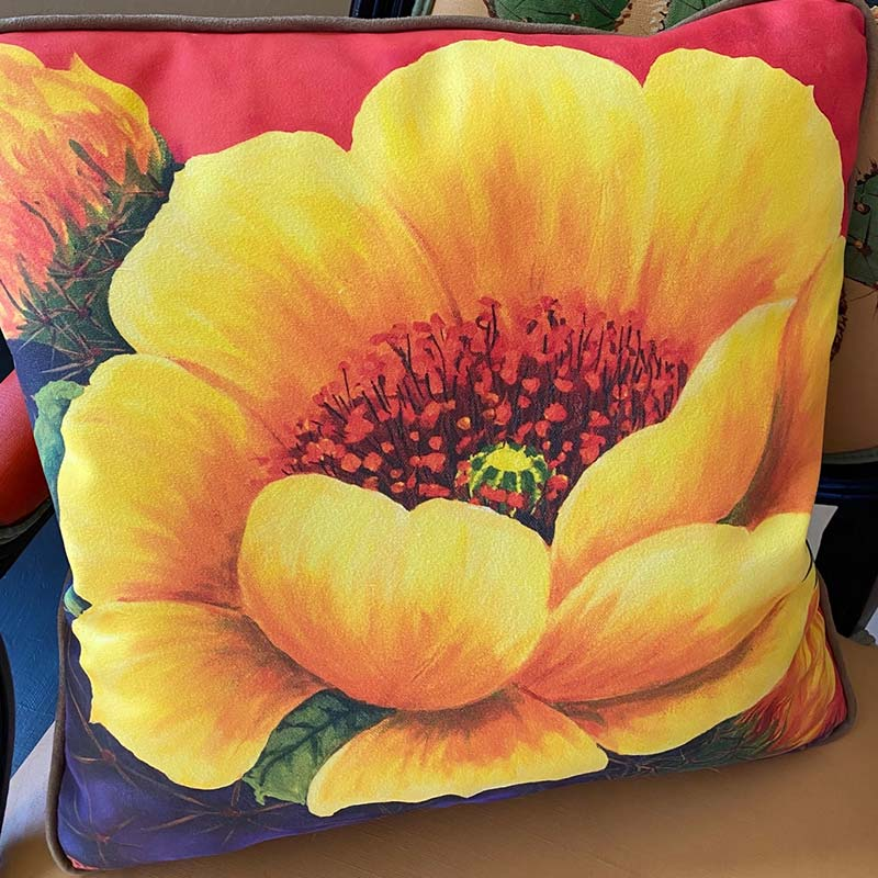 accent pillow with bright yellow flower